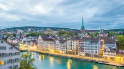 Night to day time lapse view of the old town of Zurich city