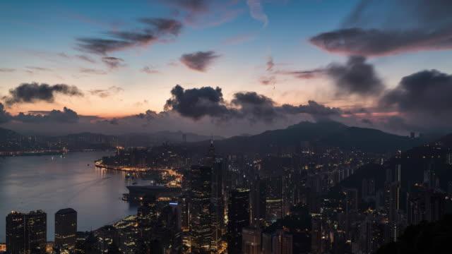 night to day timelapse of hong kong skyline - berg victoria peak stock-videos und b-roll-filmmaterial