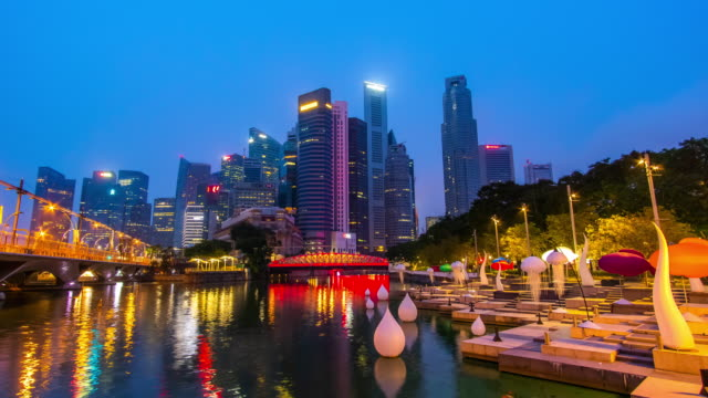 night to day timelapse of singapore cityscape - river singapore stock videos & royalty-free footage