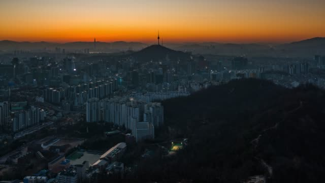 night to day timelapse sunrise scene of seoul downtown city skyline - south korea stock videos and b-roll footage