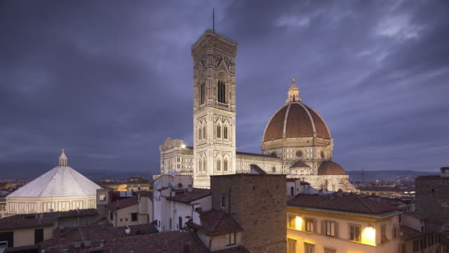 night to day tl of basilica di santa maria del fiore otherwise known as the duomo in florence, tuscany, italy. - duomo santa maria del fiore stock videos and b-roll footage