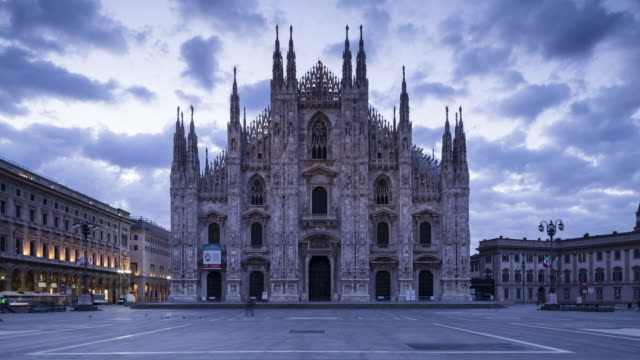 night to day tl of the duomo and piazza del duomo in milan, italy. - cathedral stock videos & royalty-free footage