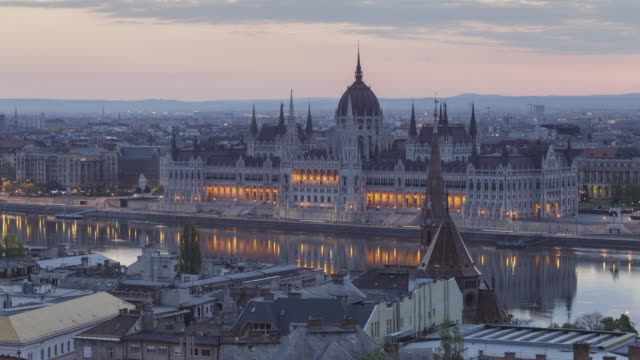 Night to day TL of the Hungarian Parliament Building and Chain Bridge in Budapest, Hungary.