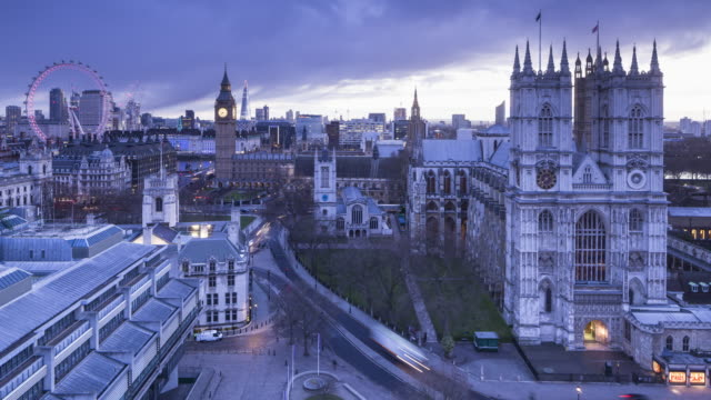 Night to day TL of Westminster Abbey, the Houses of Parliament and London Eye in London, UK.