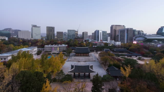 Night to day view of Deoksugung Palace and cityscape