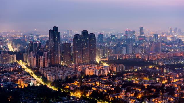 vídeos de stock, filmes e b-roll de night to day view of dogok tower palace apartment in gangnam-gu - time lapse da noite para o dia