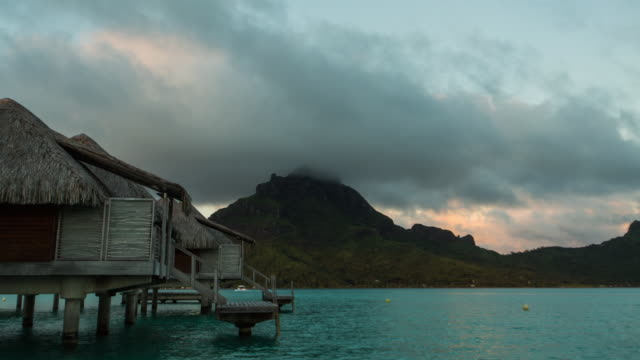 Night to day view of Mt Otemanu and bungalow
