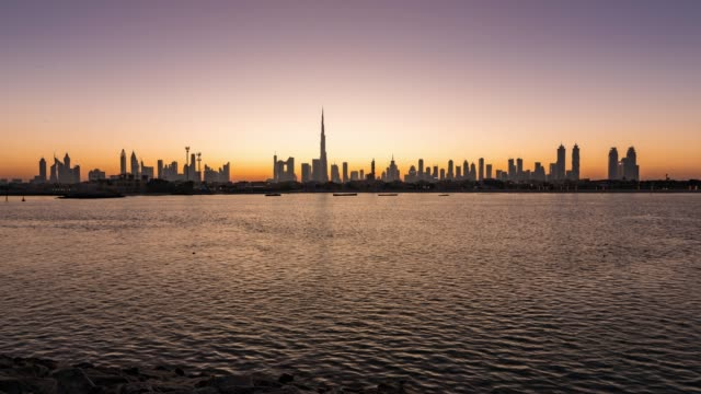 night to day/time lapse dubai skyline at sunrise / dubai, uae - skyline stock videos & royalty-free footage