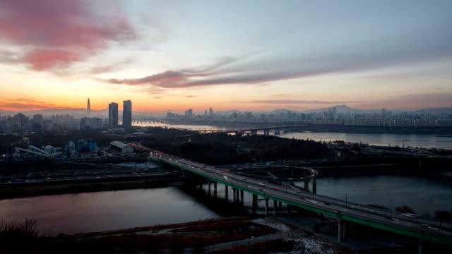 night to sunrise landscape of seoul's seongsu bridge, yongbi bridge and han river - dawn点の映像素材/bロール