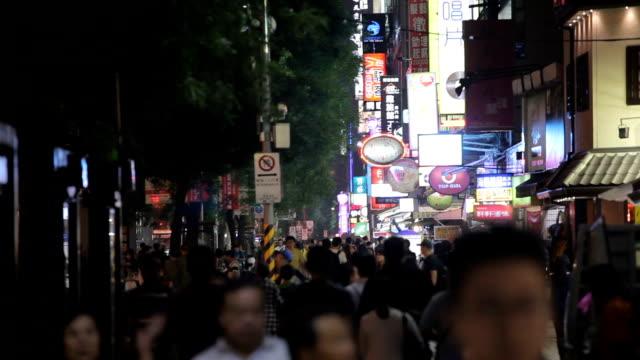 Night traffic and crowd people of in ximending Taipei, Taiwan