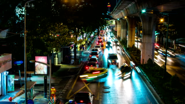 night traffic and traffic congestion in business district, bangkok, thailand - traffic time lapse stock videos & royalty-free footage