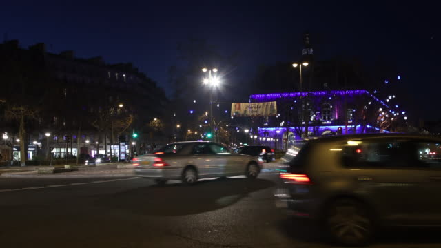night traffic at a road intersection - tail light stock videos & royalty-free footage