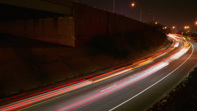 TL WS Night traffic Brooklyn-Queens Expressway ramp with planes taking off in background/ New York City