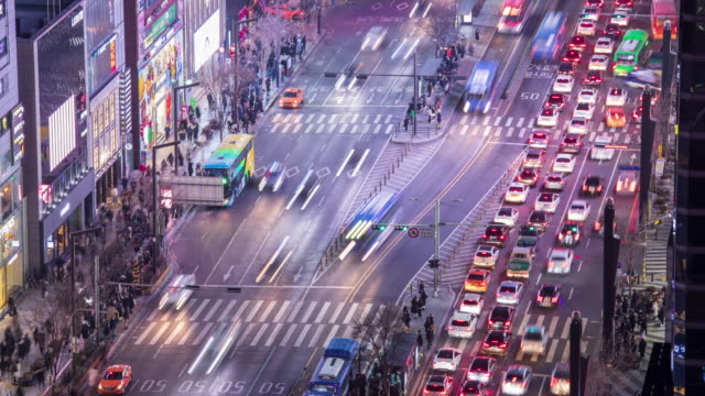 stockvideo's en b-roll-footage met night traffic on gangnamdaero road near gangnam subway station / gangnam-gu, seoul, south korea - straatnaambord