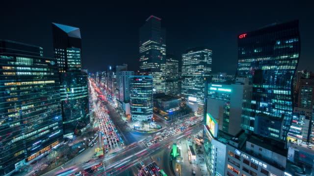 stockvideo's en b-roll-footage met night traffic on intersection of gangnam subway station / gangnam-gu, seoul, south korea - straatnaambord
