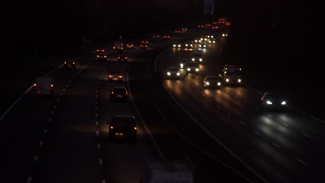 night traffic on major road. realtime lockdown. - motorway stock videos & royalty-free footage