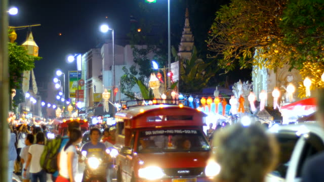 night traffic on scenic road decorated with illuminating lanterns in city, thailand - chiang mai province stock videos & royalty-free footage