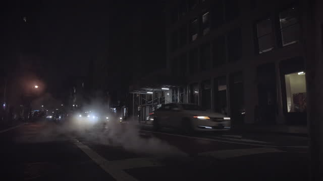 night traffic with on broadway in soho nyc with steam - broadway manhattan stock videos & royalty-free footage