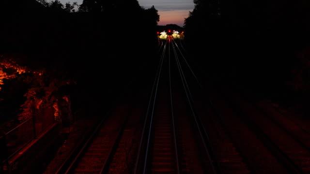 night train suburban london - over head shot - night stock videos & royalty-free footage