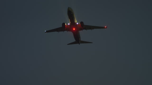 LS TS LA night, twin turbine aircraft in flight, RED R3D 4K