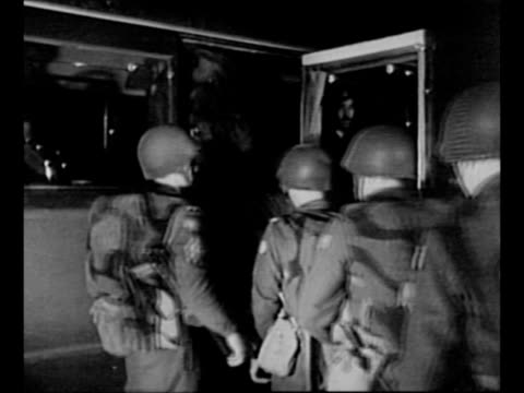 united nations peacekeeping forces disembark from ship in suez canal zone / group of military officers stands / montage un troops board military... - 平和維持点の映像素材/bロール