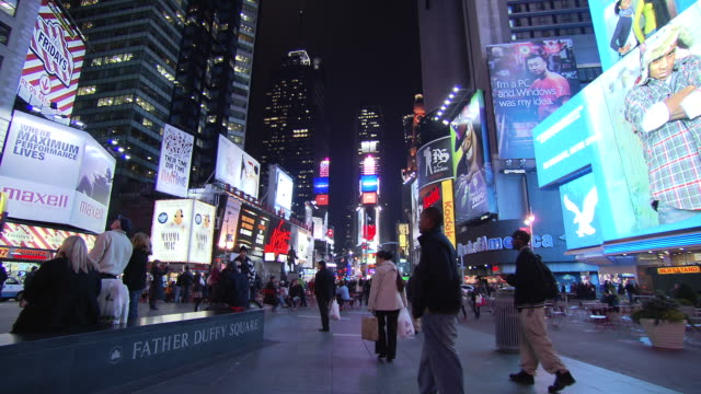 WS Night view around Time Square with people walking on street / New York, United States