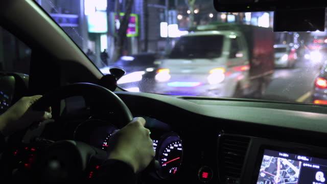 night view from inside car running in downtown / seoul, south korea - insegna di negozio video stock e b–roll