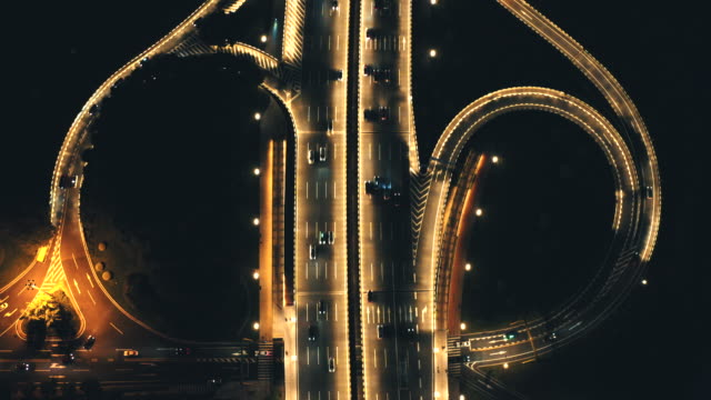 night view of a butterfly-shaped overpass - blues stock videos & royalty-free footage