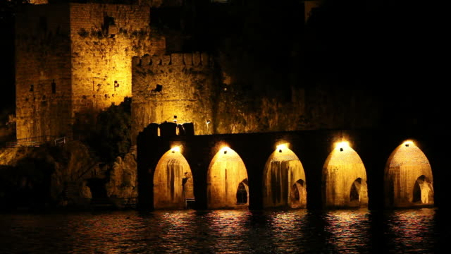 night view of alanya castle and historical shipyard - moated castle stock videos and b-roll footage