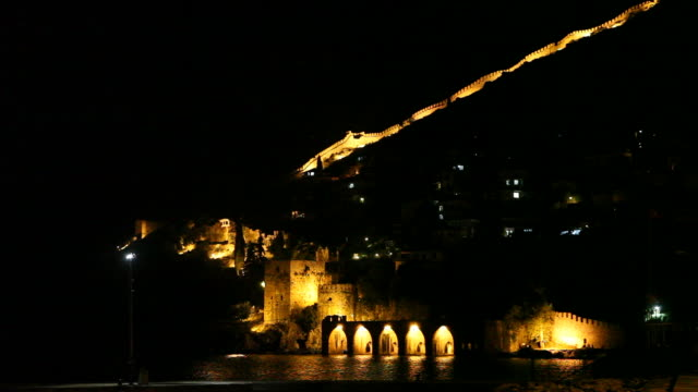 Night view of Alanya castle and historical shipyard