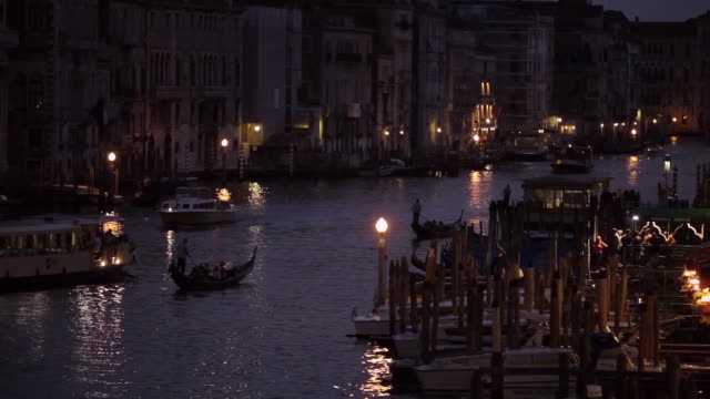 ws ld night view of boats floating down grand canal / venice, italy - grand canal venice stock videos & royalty-free footage