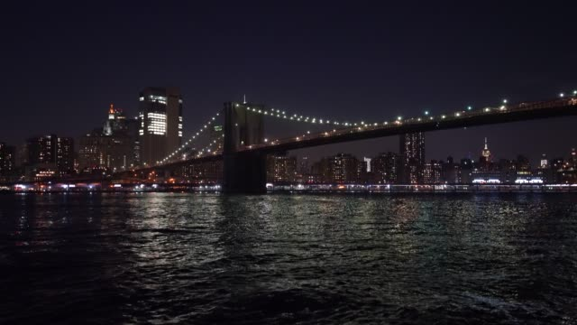 night view of brooklyn bridge / new york city, usa - brooklyn bridge stock videos & royalty-free footage
