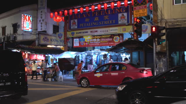 night view of busy shopping street at chinatown , kuala lumpur , malaysia - kuala lumpur stock videos & royalty-free footage
