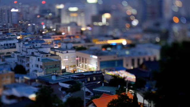 Night view of city and  Paldalmun(Korea Treasure 402) and passing cars on the road in Suwon Hwaseong (UNESCO World Heritage Sites)