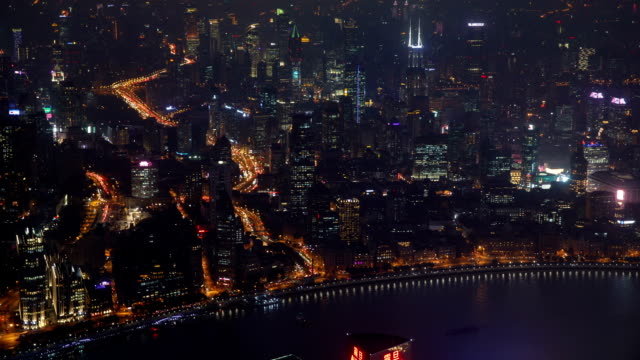 night view of city buildings on the huangpu river in the bund(waitan) area, shanghai, china - wide stock videos & royalty-free footage