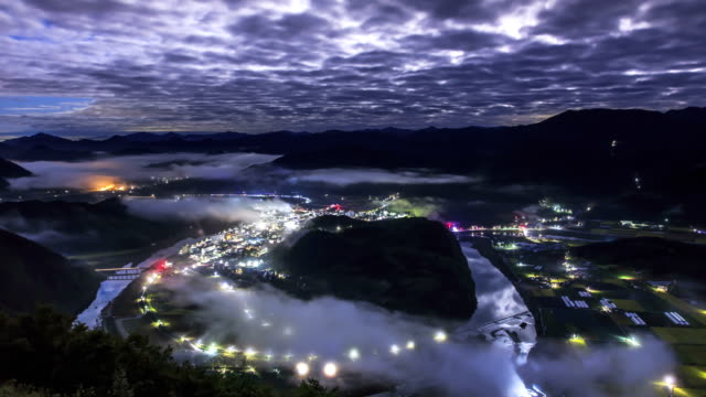 Night view of cloud sea over mountain range and small village in Pyeongchanggun, Gangwon Province