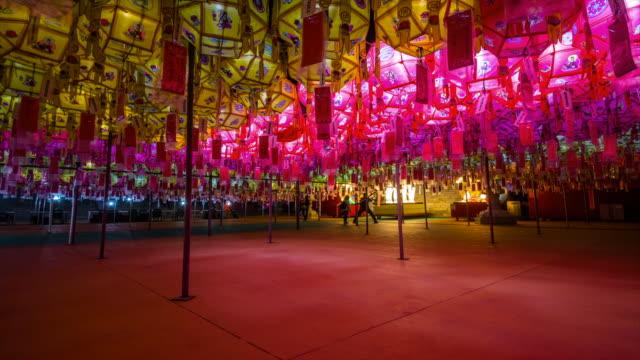 night view of colorful paper lanterns and prayers at samgwangsa temple on buddha's birthday - buddha's birthday stock videos and b-roll footage