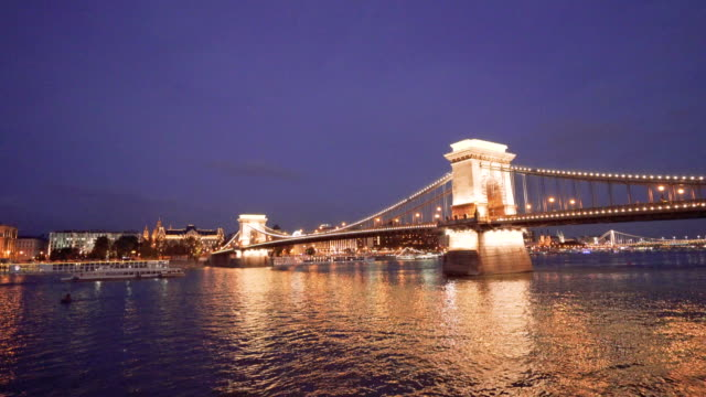 night view of danube river and chain bridge in morning in budapest in hungary - chain bridge suspension bridge stock videos & royalty-free footage