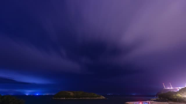 night view of desert island and harbor with cloudscape at oenalo island in goheunggun, jeollanam-do - astronomy stock videos & royalty-free footage