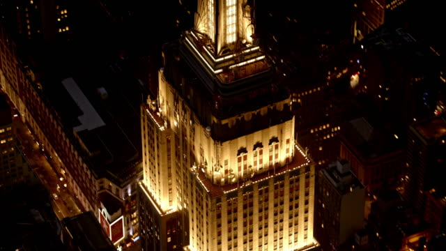 aerial night view of empire state building - empire state building stock videos & royalty-free footage