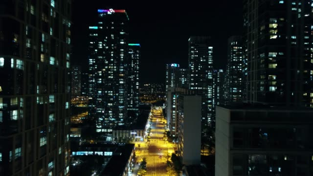 night view of flying through city buildings in songdo, incheon, south korea - neon stock videos & royalty-free footage