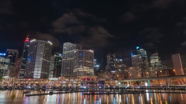 Night view of fountain show and city buildings on the Darling Harbour during Vivid Sydney Festival in Sydney, Australia