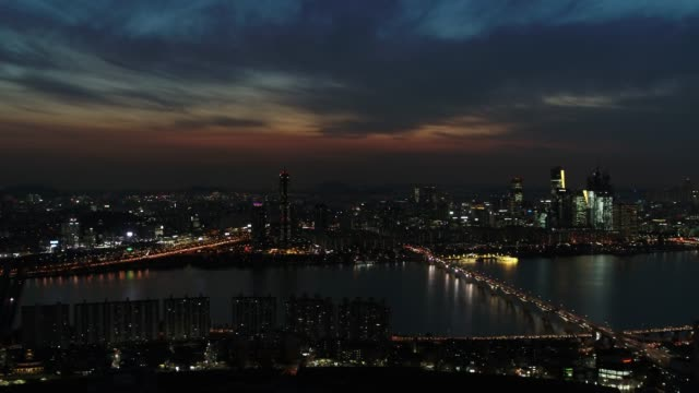 night view of han river and cityscape in seoul, south korea - seoul stock videos & royalty-free footage