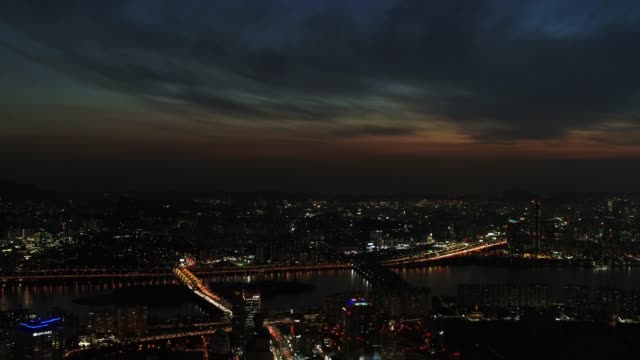 night view of han river and cityscape in seoul, south korea - moody sky stock videos & royalty-free footage