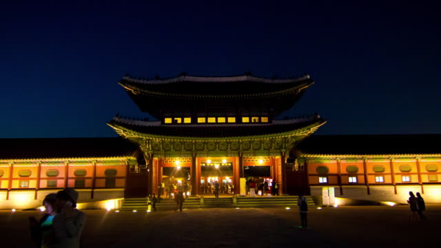 night view of heungnyemun at gyeongbokgung(palace built in chosun dynasty) with tourist - tradition stock videos & royalty-free footage