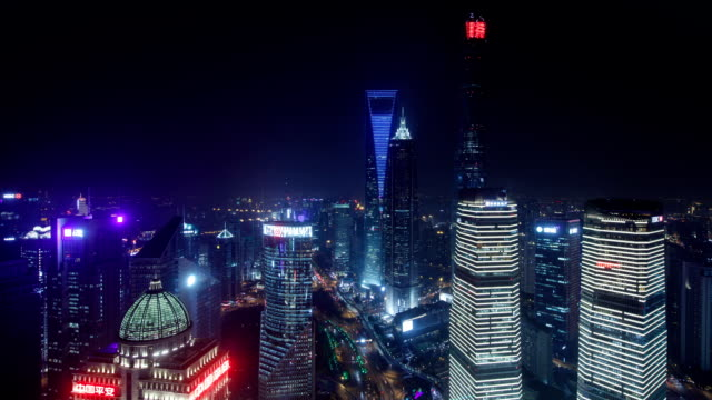 vídeos de stock, filmes e b-roll de night view of jin mao tower and  swfc, ifc with skyscrapers from oriental pearl tower observatory in shanghai, china - torre oriental pearl