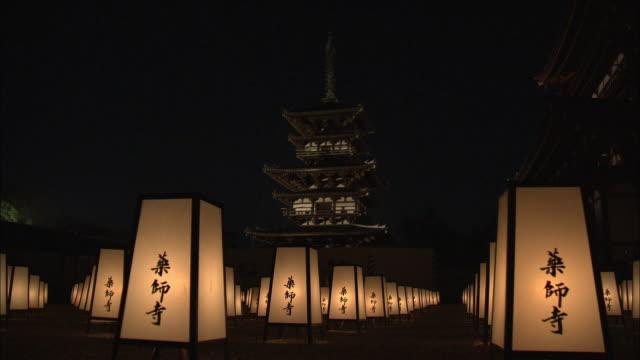 Night view of lanterns at the Yakushi-ji buddhist temple in Nara, Japan