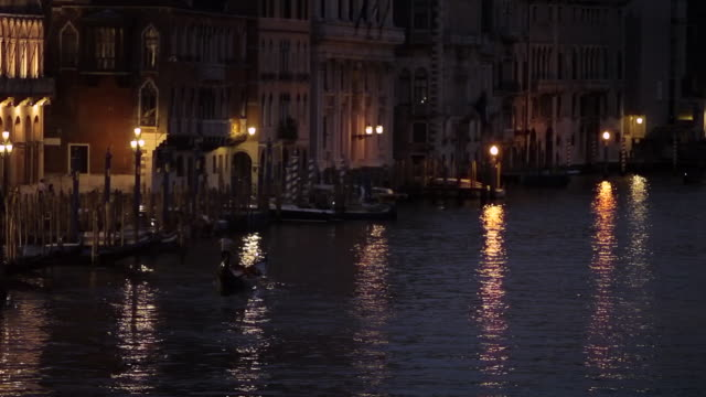 WS LD Night View of Lights Reflecting in Grand Canal at Night / Venice, Italy
