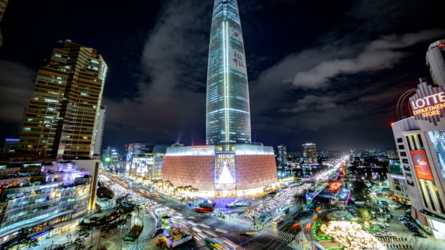 night view of lotte world tower (tallest skyscraper in korea since 2016) under construction - tower stock videos & royalty-free footage