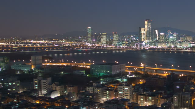 WS T/L PAN Night view of Mapo area behind Hangang river and Yeouido Business District / Seoul, South Korea